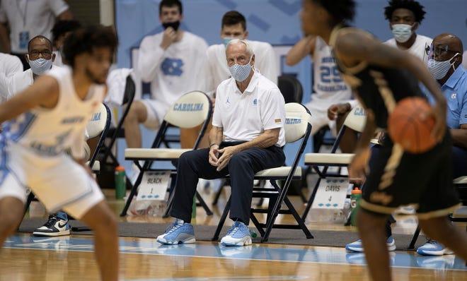 North Carolina coach Roy Williams looks on as freshman guard RJ Davis, left, defends against College of Charleston's Zep Jasper in last week's season opener.