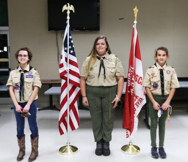 Troop 1 scouts Lily Johnson, Allison Carpenter and Aeris Sigler (left to right) have  advanced in rank and earned many merit badges during the pandemic. (TimesReporter.com / Jim Cummings)