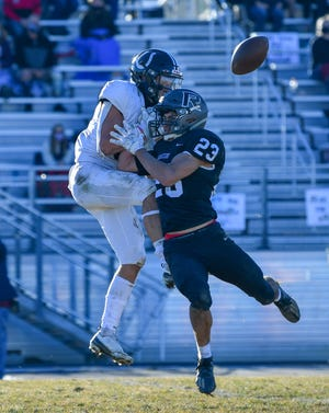 Pueblo South's Luke Guarienti, left, goes up to try and make a catch over Roosevelt's Jaden Casanueva on Saturday, Nov. 28, 2020, at Roosevelt High School in the Class 3A semifinals.