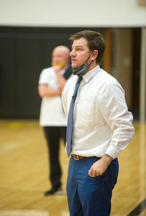 Western Reserve coach Chris Sheldon watches his team play against Colonel Crawford, his older brother David in the background does the same.
