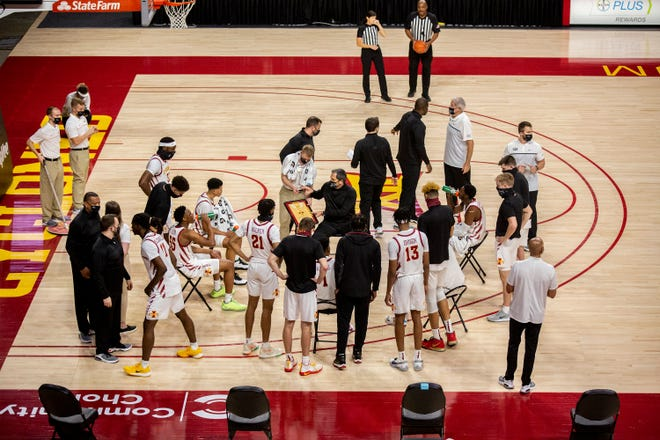 Iowa State Head Coach Steve Prohm stays socially distant from the team during a time-out during the Iowa State men's basketball season opener against Arkansas-Pine Bluff on Sunday, Nov. 29, 2020, at Hilton Coliseum in Ames, Iowa.