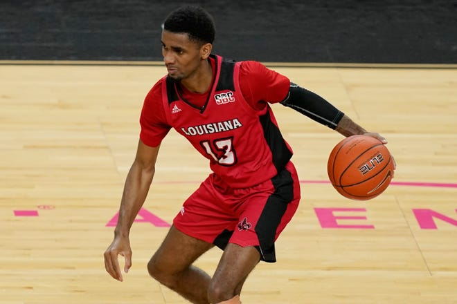 Louisiana-Lafayette guard Mylik Wilson (13) handles the basketball during a Nov. 28 game against Baylor in Las Vegas. On Monday, Wilson committed to transfer to Texas Tech. [AP Photo/John Locher]