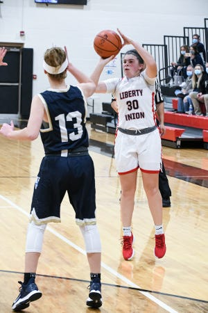 Liberty Union senior Maggie Cundiff shoots a 3-pointer in the first quarter against Teays Valley Saturday at Liberty Union High School. The Lions won, 40-33.