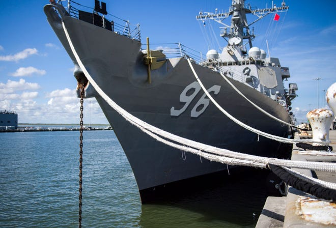 In this handout photo provided by the U.S. Navy, the guided-missile destroyer USS Bainbridge (DDG 96) utilizes heavy weather mooring to secure itself to the pier in preparation for Hurricane Florence on September 11, 2018 in Norfolk, Virginia. (Photo by Mass Communication Specialist 2nd Class Justin Wolpert/U.S. Navy via Getty Images/TNS)
