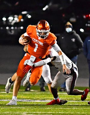 Central York Beau Pribula carries the ball while St. Joseph's Prep defends during PIAA Class 6-A Football Championship action at Hersheypark Stadium in Hershey, Saturday, Nov. 28, 2020. St. Joseph's Prep would win the title game 62-13. Dawn J. Sagert photo