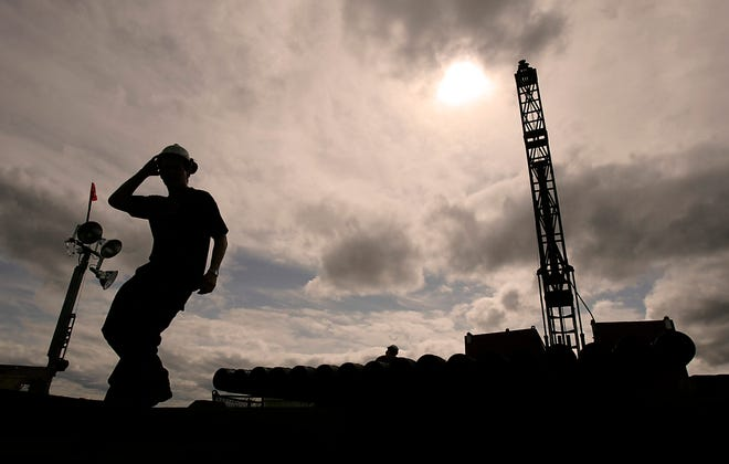 An employee of Northen Dynasty Mines Inc. mans a drilling rig in the Pebble Mine East site near the village of Iliamna, Alaska in 2007. (Luis Sinco/Los Angeles Times/TNS)