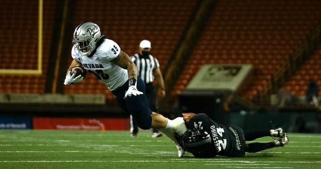 The Wolf Pack's Toa Taua finished with a game-high 131 yards Saturday at Hawaii.