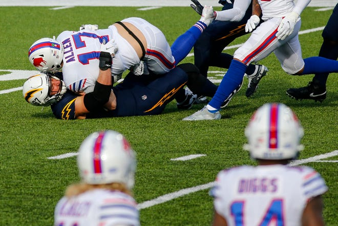 Los Angeles Chargers defensive end Joey Bosa (97) sacks Buffalo Bills quarterback Josh Allen (17) during the first half of an NFL football game, Sunday, Nov. 29, 2020, in Orchard Park, N.Y. (AP Photo/Jeffrey T. Barnes)