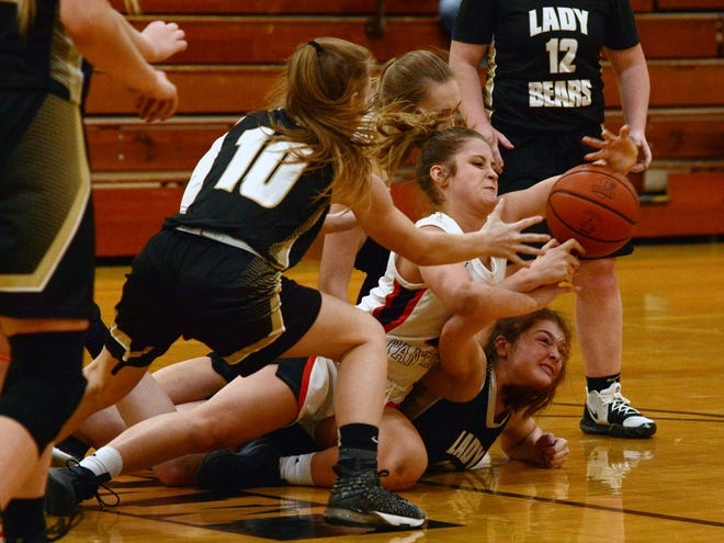 Players fight for a loose ball during New Lexington's 64-37 win against River View on Saturday in Warsaw. The Panthers improved to 2-0 in the Muskingum Valley League.