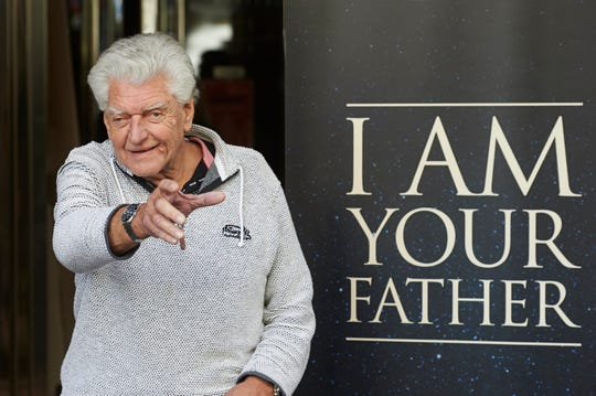 """David Prowse (seen here in 2015 at a photo call for the documentary """"I Am Your Father), who famously played Darth Vader in the original """"Star Wars"""" trilogy, has died at 85."""