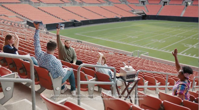 Browns quarterback Baker Mayfield, front left, and rookie offensive lineman Jedrick Wills, back center, film a commercial for Progressive at FirstEnergy Stadium in Cleveland. [Photo courtesy of Progressive]