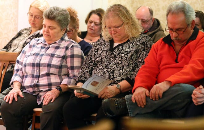 Cheryl Pagano, left, Cindy Ulrich, a family friend, and Mike Pagano listen during the memorial service for their sister Linda Pagano, 17, an Akron teen who disappeared in 1974 and whose remains were identified in 2018.