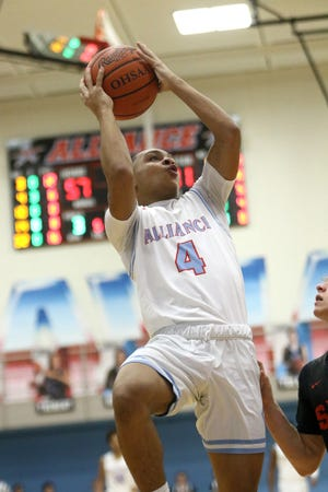 Alliance's Gage Ford drives to the basket in a game against Salem in January 2020.