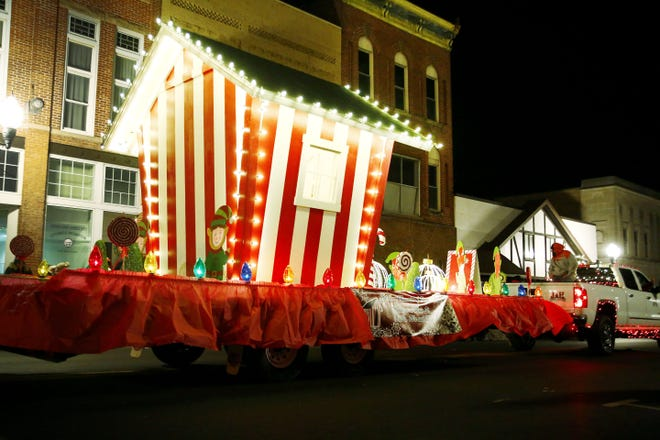 J&H Landscaping's float in last year's Ashland Christmas Parade carries a replica of the Santa house that once stood on Main Street during the Christmas season during the 1960s-1980s. This year's Ashland Christmas parade will be Saturday, Dec. 5.