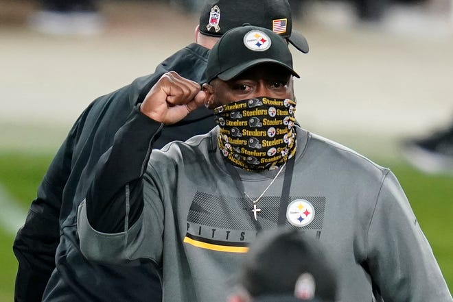 Pittsburgh Steelers head coach Mike Tomlin celebrates as he walks off the field following a win over the Cincinnati Bengals during an NFL football game on Nov. 15 in Pittsburgh.