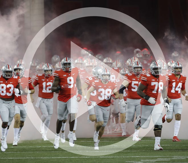 In this file photo, Ohio State Buckeyes players take the field for the NCAA football game against the Rutgers Scarlet Knights at Ohio Stadium in Columbus, Ohio on Saturday, Nov. 7, 2020. Ohio State won 49-27.