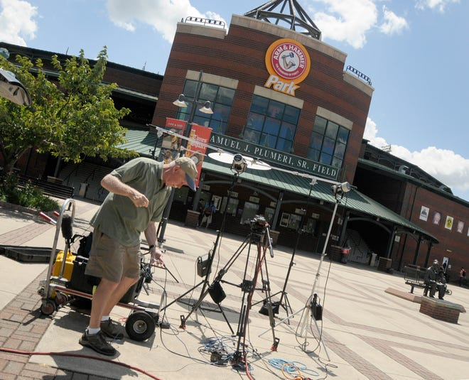 An audio engineer for ESPN breaks down equipment outside Arm & Hammer Park in Trenton, N.J. Major League Baseball is creating a minor league for top eligible prospects leading to the summer draft, the league announced Monday.