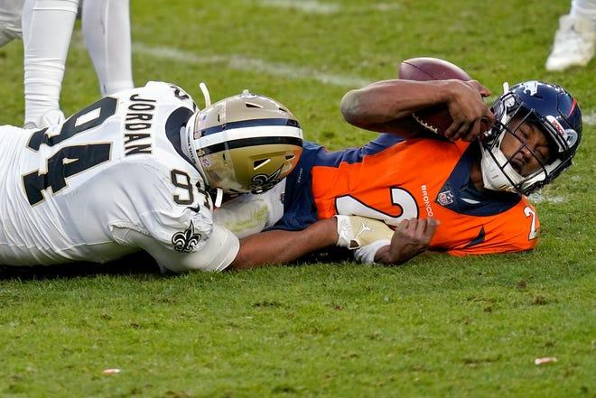 New Orleans Saints defensive end Cameron Jordan (94) sacks Denver Broncos quarterback Kendall Hinton (2) during a game Sunday in Denver.