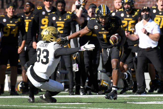 Missouri running back Tyler Badie runs past Vanderbilt safety Dashaun Jerkins on Saturday at Faurot Field.