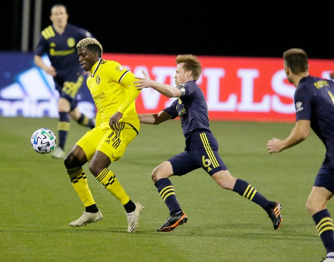 Crew forward Gyasi Zardes and Nashville SC midfielder Dax McCarty (6) compete during the first half of Sunday's MLS Eastern Conference semifinal.