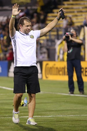 """Former Crew player Alejandro Moreno, now an analyst for ESPN, acknowledges applause during """"Alumni Night"""" at Mapfre Stadium in August 2019."""