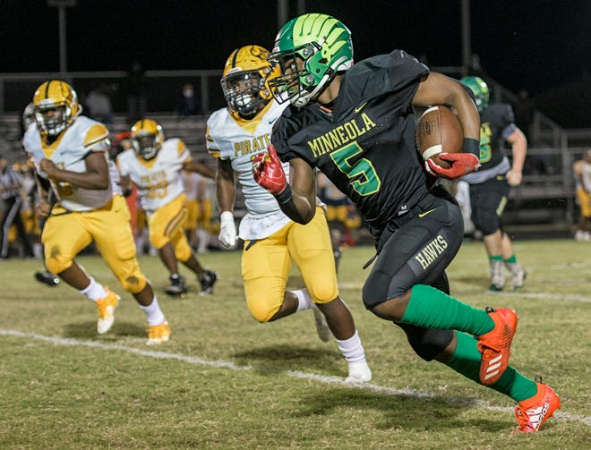 Lake Minneola running back Duke Walker (5) runs for yardage during a Class 6A-Region 2 quarterfinal game Gulfport Boca Ciega on Nov. 20 in Minneola. The Hawks host Tampa Gaither Friday for the regional championship. [PAUL RYAN / CORRESPONDENT]