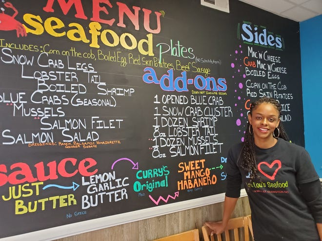 Chef Nailah Curry stands near the menu board in her restaurant Lou Lou's Seafood. The business, which will operate mainly as a take-out food service, is located at 514 N. Main St. She and husband Josh Curry plan to open Lou Lou's in mid-December.