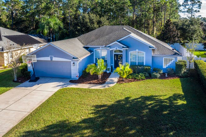 Nestled on a wonderful lot in the desirable, gated Ormond Beach community of Breakaway Trails, this outstanding home offers incredible privacy, with a wooded patch of land that is part of a 10-acre homestead just over the privacy fence.