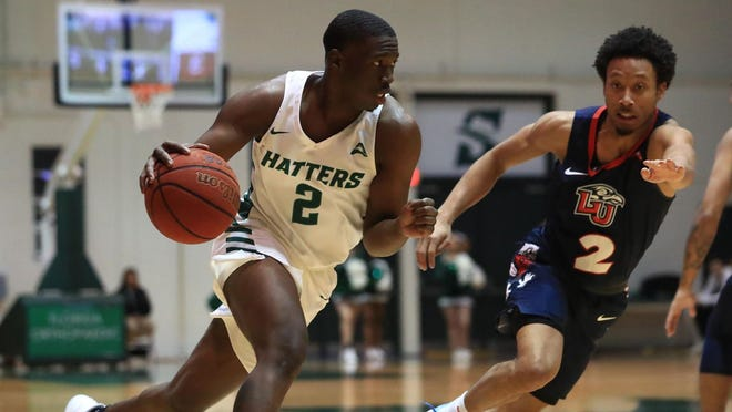 Rob Perry, left, is being counted on to help the Stetson men's basketball team improve even more in the 2020-21 season. The 6-foot-4 sophomore guard led the Hatters to their highest win total, 16, in 12 years last season.
