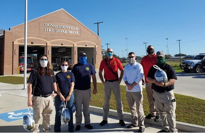 Members of the Donaldsonville Fire Department Association assisted with the distribution of turkey prior to Thanksgiving.