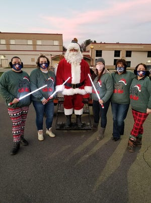 Santa and his elves bring holiday cheer to Canisteo on Saturday, Nov. 28. From left, Jessica Woodworth, Katrina Oliverio, Santa, Keisha Rouse, Canisteo Mayor Monica Recktenwald and Rosemary Kneale.