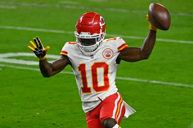 Chiefs wide receiver Tyreek Hill runs into the end zone for one of his three touchdown receptions in Kansas City's 27-24 win over the Tampa Bay Buccaneers Sunday.
