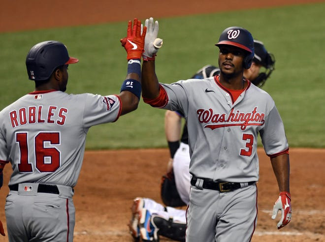 Washington Nationals outfielder Michael Taylor (3) is congratulated by teammate Victor Robles (16) after hitting a home run. Taylor signed a 1-year deal with the Kansas City Royals Monday.