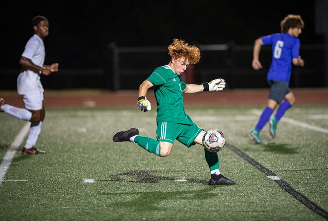 Van Horn senior goalkeeper Cooper Sumpter boots the ball downfield during a game against Blue Springs this season. Sumpter, who didn't take up soccer until his sophomore year, earned second-team all-state honors for the 21-4 Falcons this season.