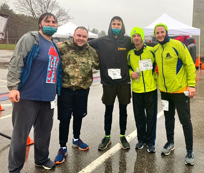 Continuing a family tradition of running a 5k on Thanksgiving morning was the Boyle family of Eliot Maine.  Grandfather Brian Boyle, his son Daniel Boyle, and grandsons Ethan, Austin and Gavin completed the race.