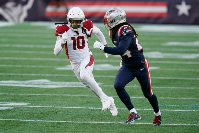 Arizona Cardinals wide receiver DeAndre Hopkins, left, runs a pass route as New England Patriots cornerback Stephon Gilmore defends in the second half of an NFL football game, Sunday, Nov. 29, 2020, in Foxboro.