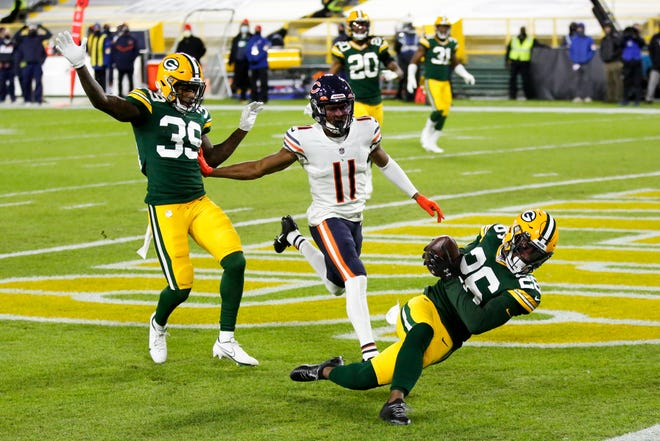 Green Bay Packers safety Darnell Savage intercepts a pass in the end zone in front of Chicago Bears wideout Darnell Mooney during the first half of Sunday night's game in Green Bay, Wis. (AP Photo/Matt Ludtke)