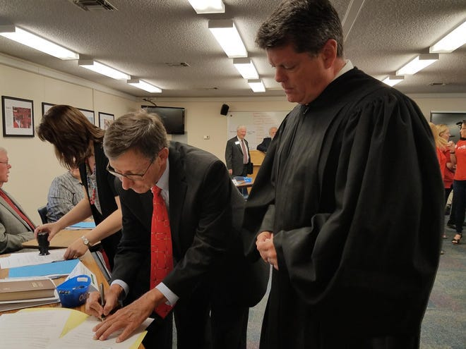 Re-elected Onslow County Board of Education member Ken Reddic sworn into office in 2018.