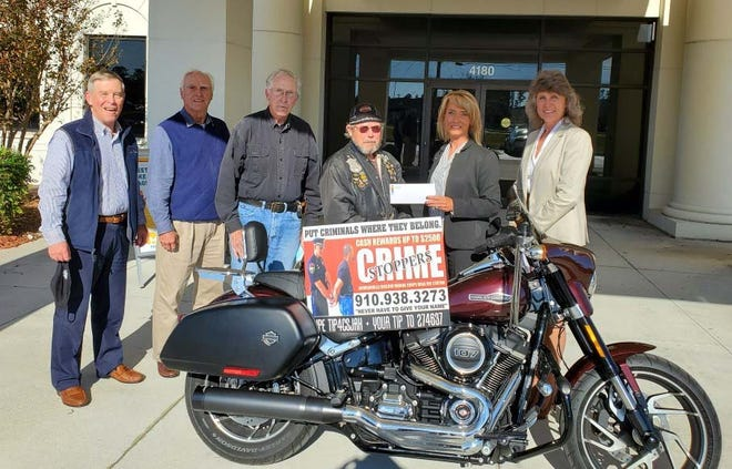 Blue Knights Motorcycle Club recently presented a $2,370 donation to Crime Stoppers. Pictured are Joe Yannessa, Bob Bright, both of Crime Stoppers; Glen Camp and Jim Myers, both of Blue Knights; Kim Conard and Robin Bright of Crime Stoppers.Blue Knights provide financial assistance to community programs and needy causes in Onslow County.