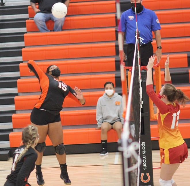 Southwest's Shaylin Pollock goes up to hit the ball over the net in the Stallions' 25-16, 25-7, 25-16 win over Lejeune on Nov. 23. [Chris Miller / The Daily News]