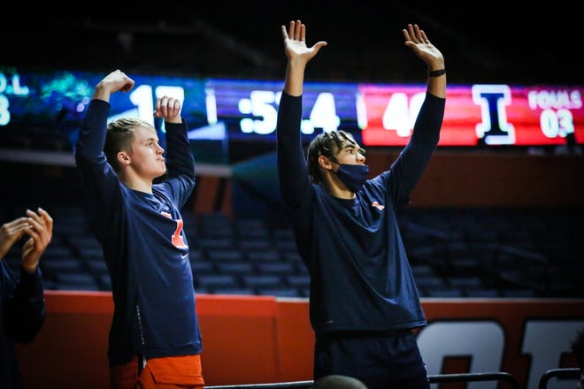 Illinois men's basketball player Connor Serven, left, celebrates during a game last week at State Farm Center in Champaign.