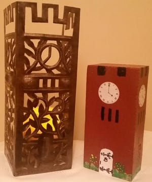 The Woman's Club of Hudson is offering two handmade items for public purchase. The hand-painted Hudson Clock Tower Brick and the Clock Tower Trifold Candle Cover.