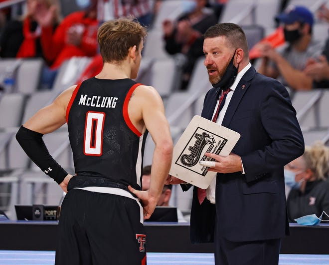 Texas Tech coach Chris Beard talks to Mac McClung (0) during a nonconference game Sunday against Houston as part of the Southwest Shootout at Dickies Arena in Fort Worth. The No. 17 Red Raiders are set to host Troy for an 8 p.m. Friday game on ESPN2.