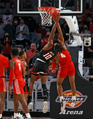Texas Tech's Tyreek Smith (10) and Houston's Justin Gorham (4) try to rebound the ball during the game against Houston, Sunday, Nov. 29, 2020, at Dickies Arena in Fort Worth, Texas.