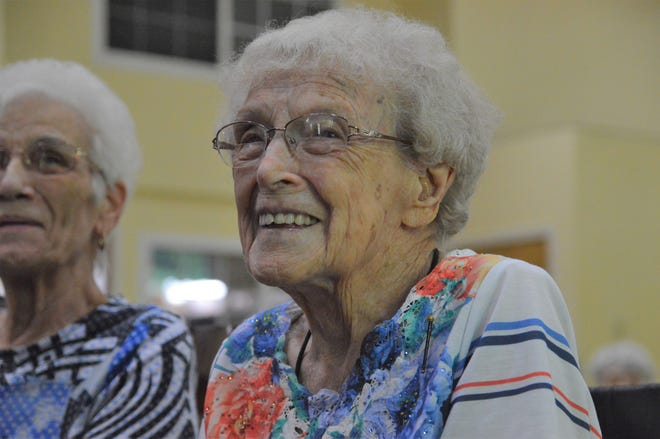 Norma Schofield smiles after receiving the Boston Post Cane pin in May 2018 for being Leominster's oldest resident.