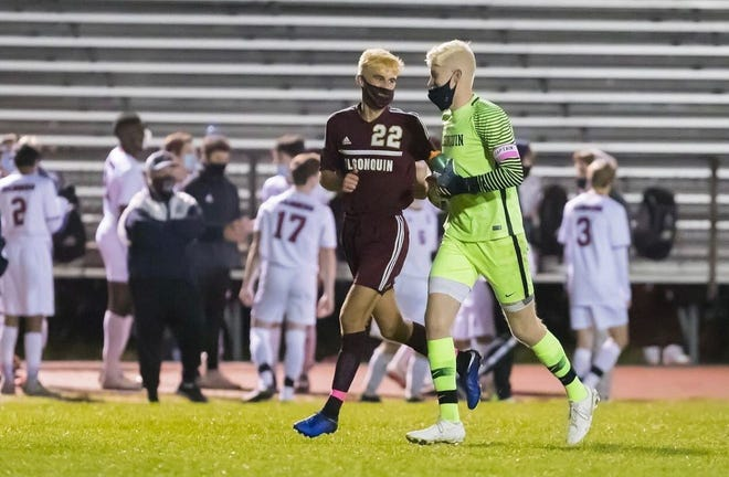 "Algonquin senior soccer players Nick Alcock (left) and Brendan McCarthy race on the field together during a game earlier this fall. The two wrapped up their careers representing ""GONK"" on Sunday."