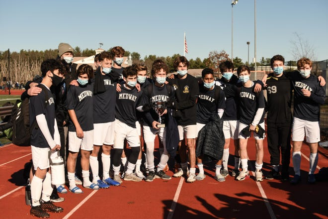 Boys soccer players from Medway celebrate winning the Division 3 MA Spartans Soccer Competition on Sunday at Medway High.