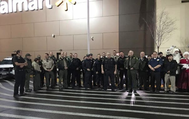 Local law enforcement officers, Santa and Mrs. Claus in front of Walmart during the 2016  Shop with a Cop event, which has been canceled in 2020 due to the pandemic.