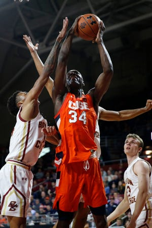 Syracuse's Bourama Sidibe (34) shoots against Boston College in an NCAA college basketball game from March, 3, 2020, in Boston. Sidibe will need knee surgery this season.