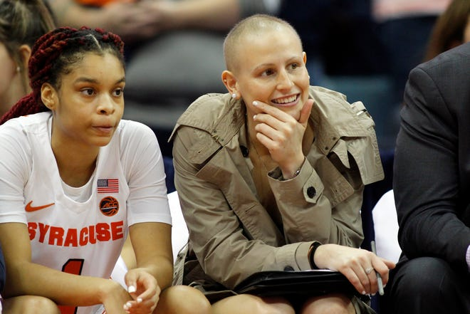 In this Nov. 24, 2019, file photo, Syracuse's Tiana Mangakahia, right, sits on the Syracuse bench during an NCAA college basketball game against Oregon in Syracuse. Mangakahia returned to the basketball court Sunday, scoring 16 points in an SU win, after not playing competitively for 615 days while battling breast cancer.